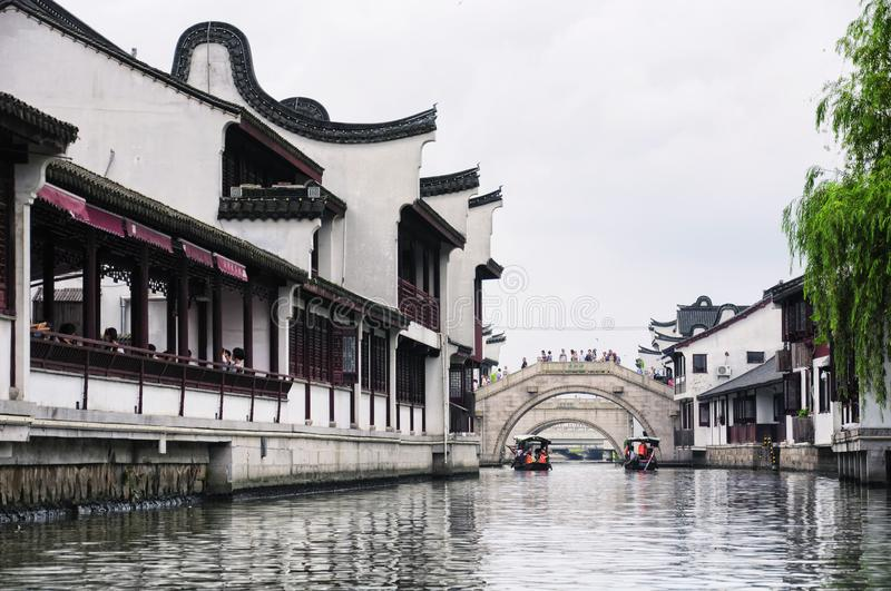 Zhaojialou Water Town Shanghai China. Tourist boats on the old yaojiabang river and the water canals of Zhaojialou in Shanghai China on an overcast day stock photos