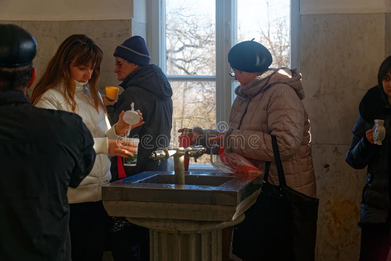 People in drinking gallery of natural mineral water Narzan in pump room in Kislovodsk spa town. stock photography