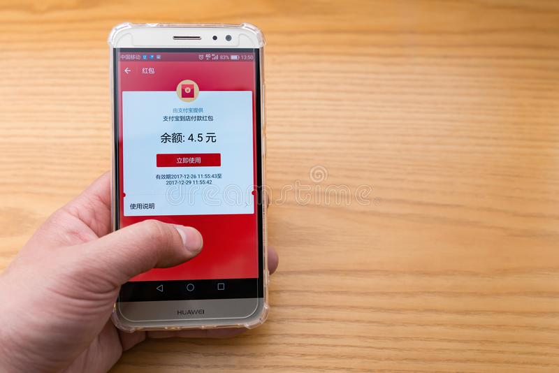 Chinese man checking the Alipay red pocket on the mobile stock image