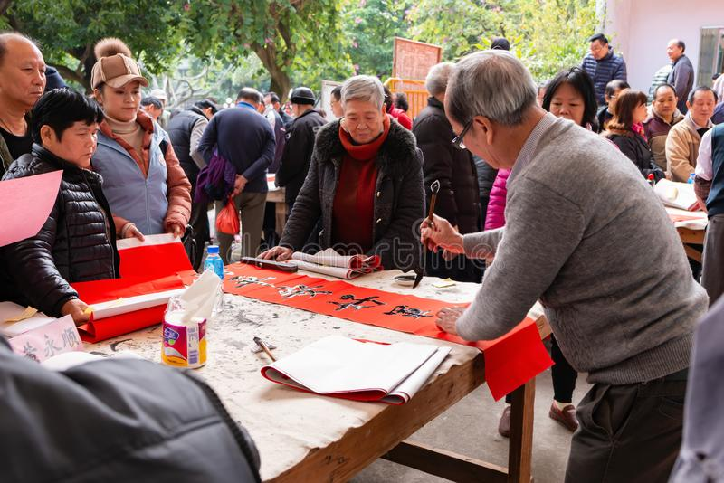 People writing Chinese new year scrolls royalty free stock photo