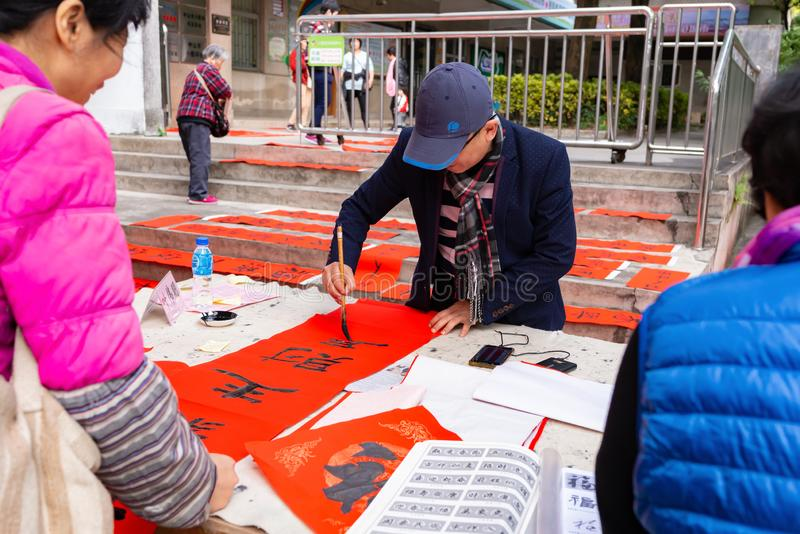 People writing Chinese new year scrolls royalty free stock image