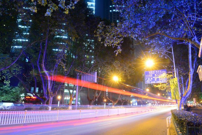 Zhongshan East Road, Nanjing, China. Daxinggong bus stop on Zhongshan East Road (Zhongshan Lu) at night in downtown Nanjing, Jiangsu Province, China royalty free stock photo