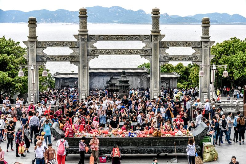 Zhoushan, Zhejiang, China - MAY 06, 2018 : buddhists come to pray for blessing and wish in a hope and visiting go to Guanyin. Temple near the sea on the island stock image