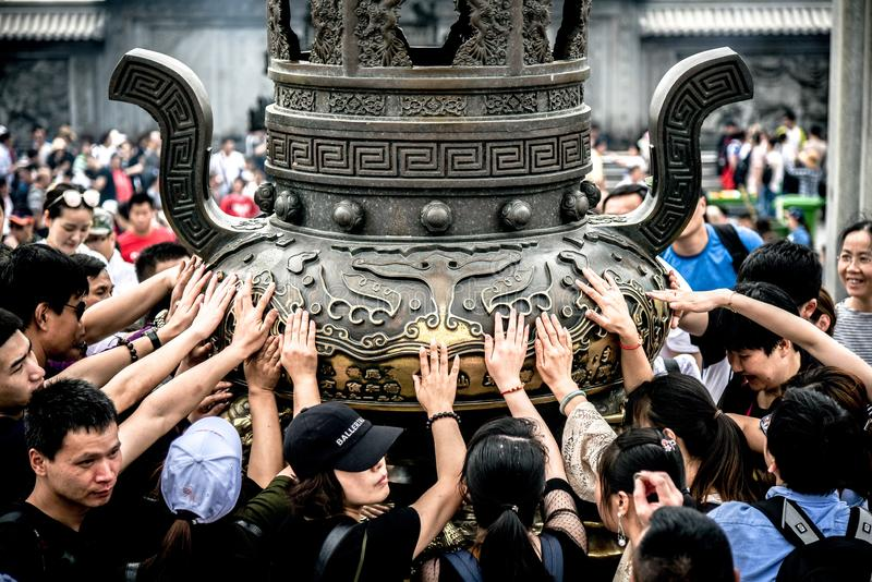Zhoushan, Zhejiang, China - MAY 06, 2018 : : Putuoshan Mountain is the abode of Goddess of mercy Guanyin  buddhists come to pray. And use Hand touch a sacred royalty free stock images