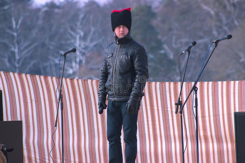 Zhytomyr, Ukraine - May 05, 2015: man with fun hat and microphone stock photo