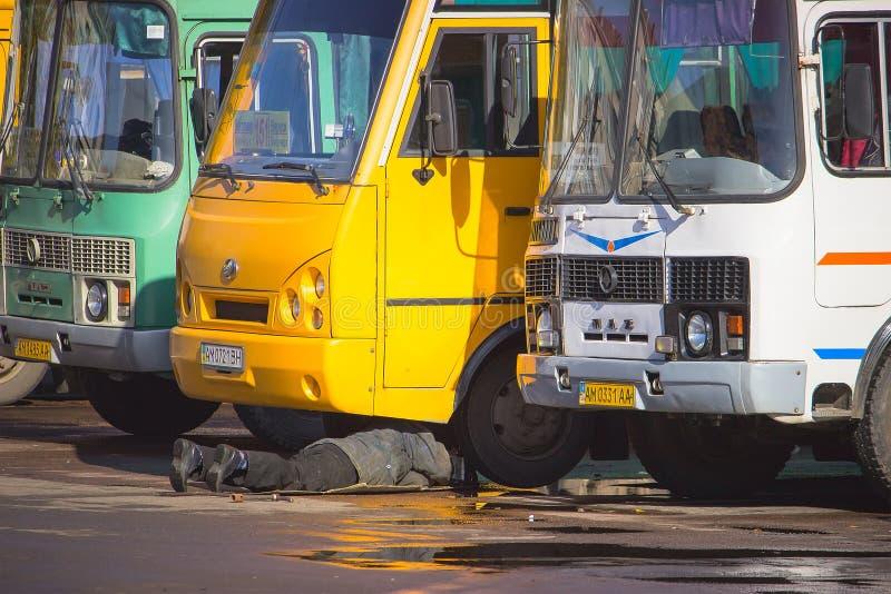 Zhytomyr, Ukraine - October 16, 2017: Mechanic changing flat tire at bus breakdown royalty free stock photos