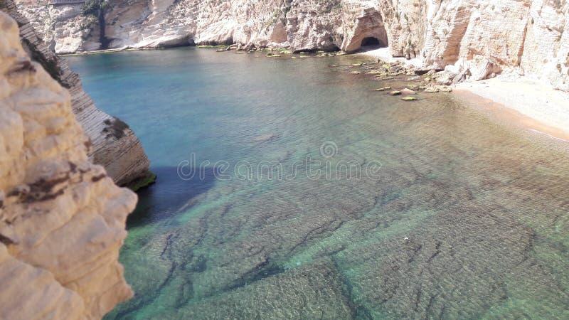 Zie de steen onder watermening stock afbeelding