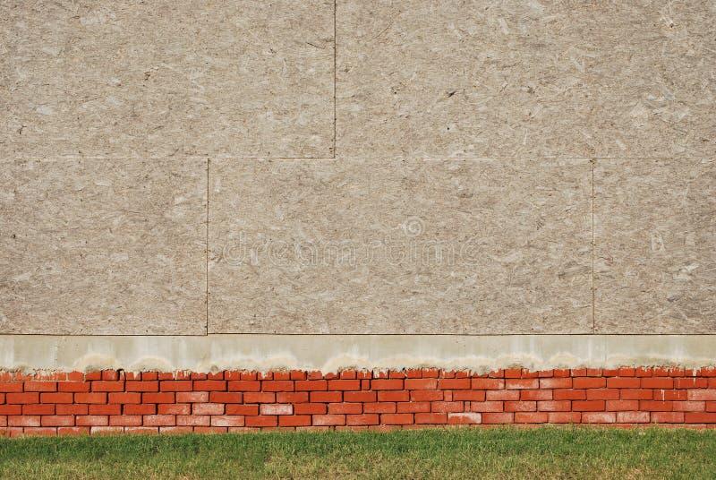 Ziegelstein-und Furnierholz-Wand-Hintergrund lizenzfreie stockbilder