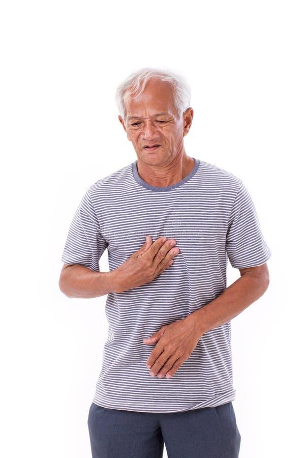Zieke oude mens die aan het zuur, zure terugvloeiing lijden stock afbeeldingen