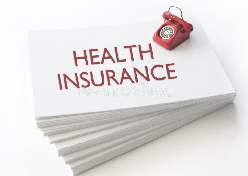 Ziektekostenverzekeringadreskaartje stock fotografie