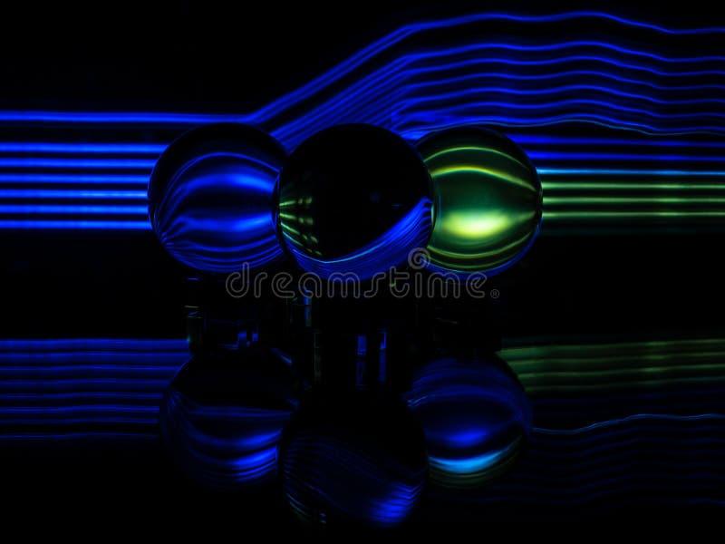 Zieleń, błękit i czerń, Odbijamy w wieloskładnikowym Lensballs obrazy stock