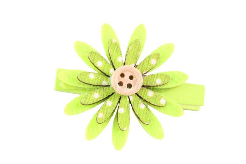 Zieleń sztucznego kwiatu hairpin odizolowywający na bielu fotografia stock