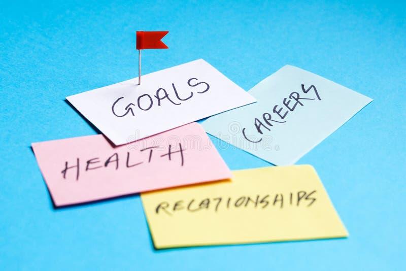 Ziele in den Karrieren, in der Gesundheit und in den Verhältnissen stockfotos
