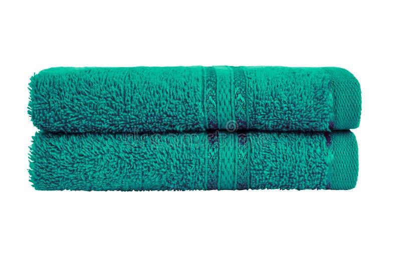 Zieleni kąpielowi ręczniki w stercie t?a ?cinku odosobniony lifebelt nad ?cie?ki biel zdjęcie stock