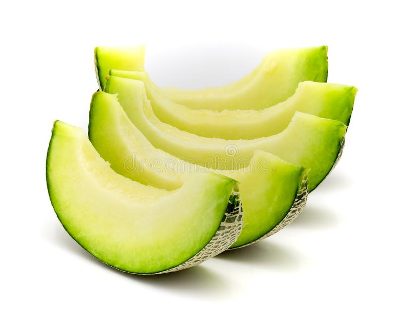 Zieleni melonów plasterki odizolowywający na białym tle zdjęcie royalty free