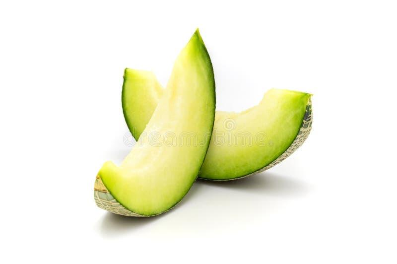 Zieleni melonów plasterki odizolowywający na białym tle zdjęcia stock