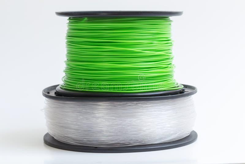Zielenieje przeciw a drucik dla 3D drukarki kryształu jasnego i jaskrawego - zdjęcia royalty free