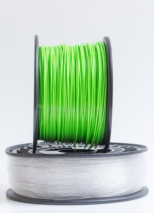 Zielenieje przeciw a drucik dla 3D drukarki kryształu jasnego i jaskrawego - obrazy stock