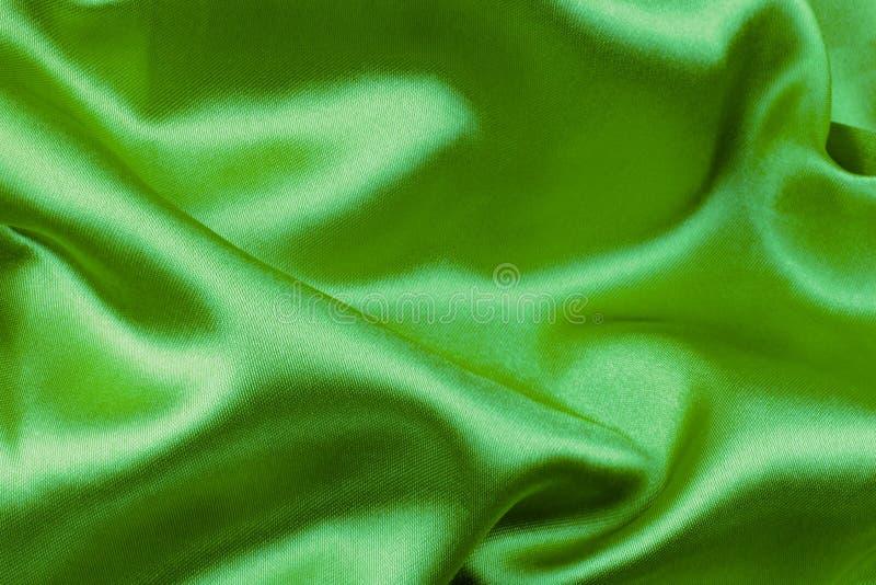 Zielona falista jedwabnicza tkanina fotografia stock