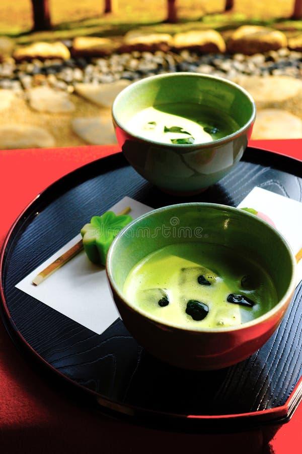 Zielona herbata i cukierki zdjęcia royalty free