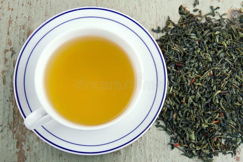 Zielona herbata w białej filiżance obraz stock