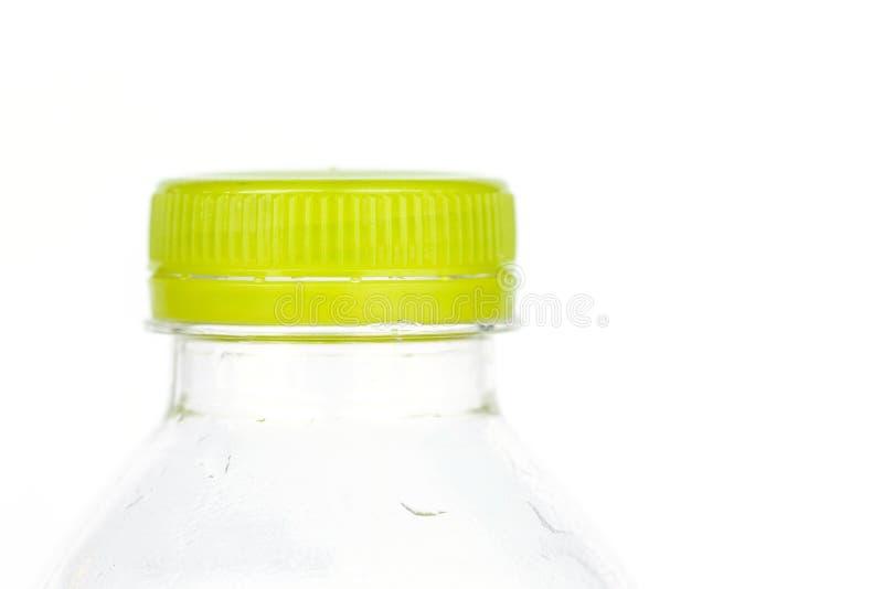 Zielona nakrętka odizolowywająca na białym backgroun plastikowa butelka zdjęcie royalty free
