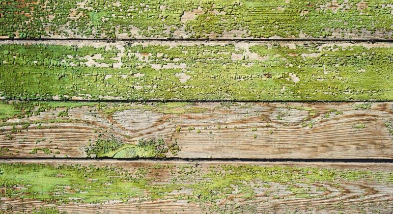 Zielona stara malująca drewniana drzwiowa tekstura jako tło zdjęcie stock
