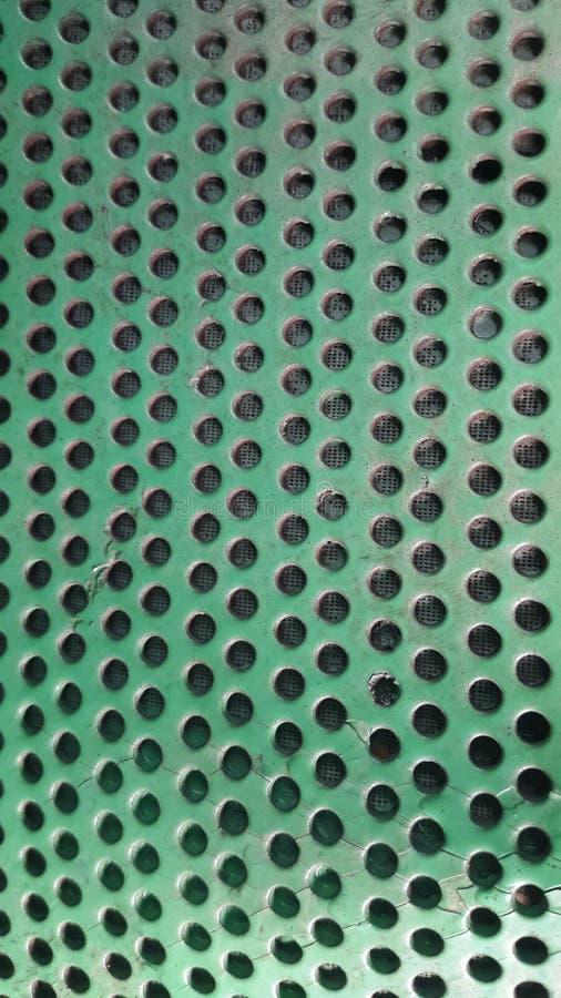 zielona tekstura z dziurami Pionowo tło z dziurami zdjęcia royalty free