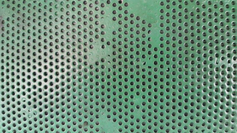 zielona tekstura z dziurami Tło z dziurami fotografia royalty free