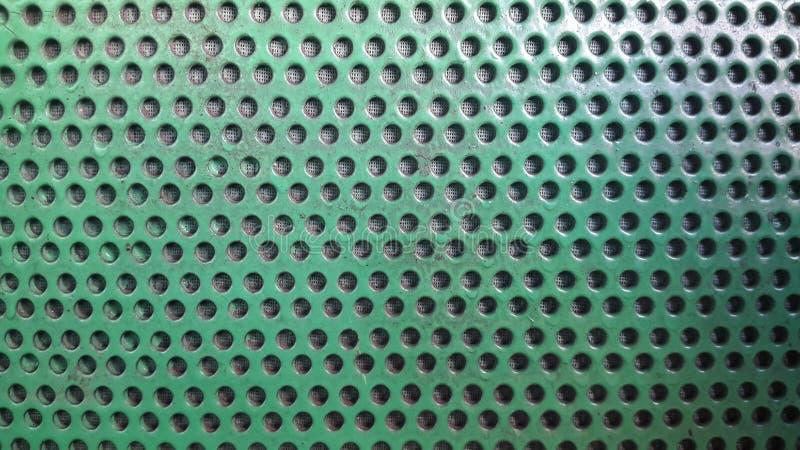 zielona tekstura z dziurami Tło z dziurami obrazy royalty free