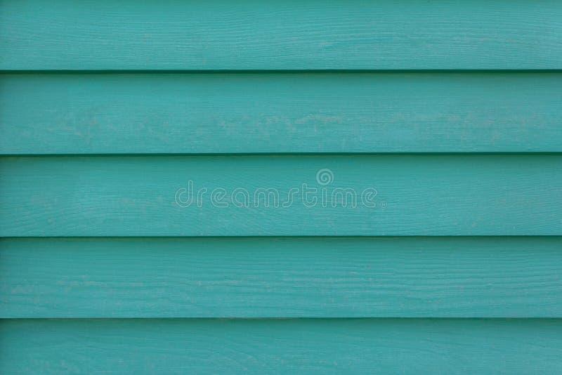 Zielone błękitne drewniane żaluzje z cieniami Horyzontalne linie Szorstkiej powierzchni tekstura obraz stock