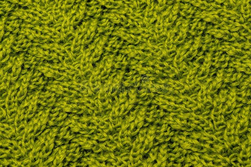 Zielonego złota wełny oliwne nici w tkaninie dziającej obraz stock