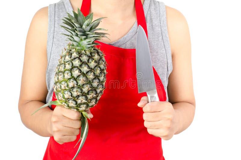 Zielony ananasowy chwyt ręką zdjęcie stock