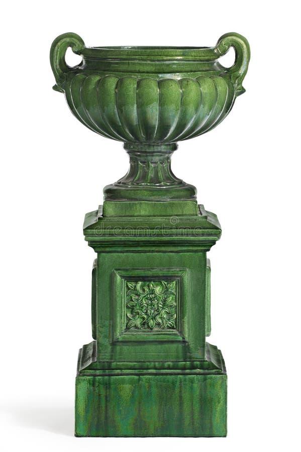 Zielony antykwarski łzawica na piedestału cokole zdjęcia stock