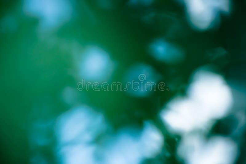 Zielony błękit zamazujący obraz royalty free