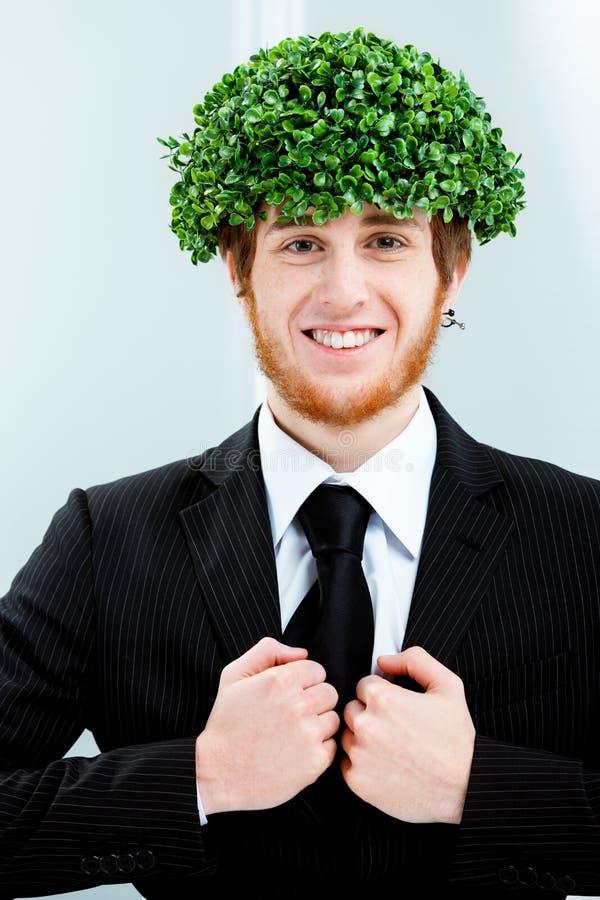 Zielony biznes i życzliwy biznesmen zdjęcie royalty free