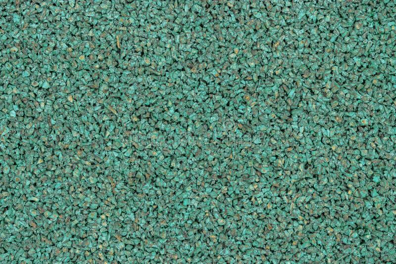 Zielony gumowy nakrycie sporty gruntuje dla dzieci Tekstury granuli struktury tło Sporta pola podłoga dla sprawności fizycznych g zdjęcia royalty free