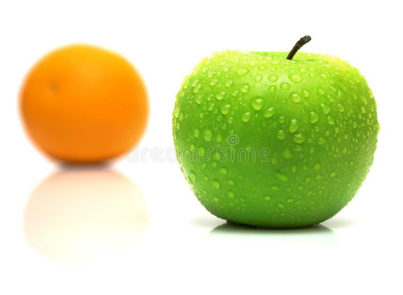 Zielony jabłko i pomarańcze obrazy royalty free