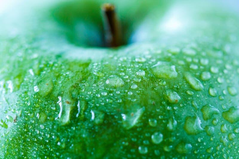 Zielony jabłko, makro- Weganinu jedzenia pojęcie obrazy stock