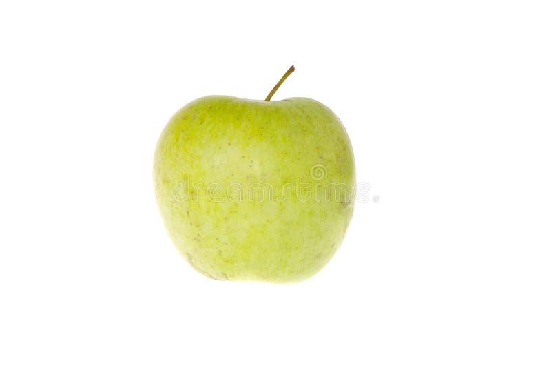 Zielony jabłko na białym tła zakończeniu zdjęcia royalty free