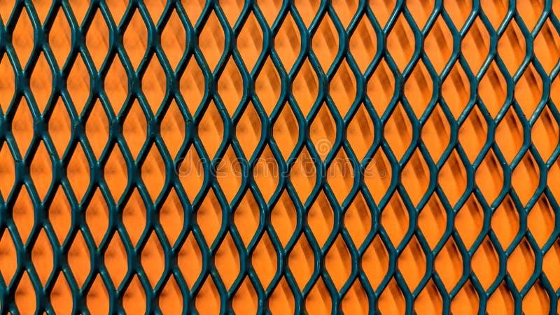 Zielony kruszcowy grill na pomarańcze papieru tle ilustracji