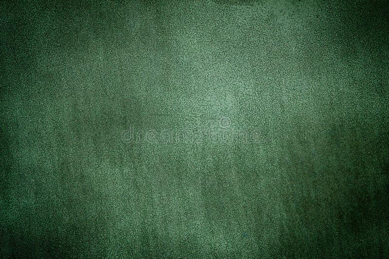 Zielony metalu talerza tła zmrok ostrzący zdjęcia royalty free