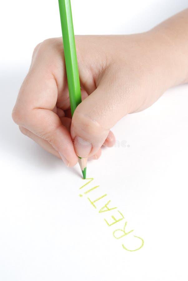 zielony ręki ołówka słowa writing fotografia stock