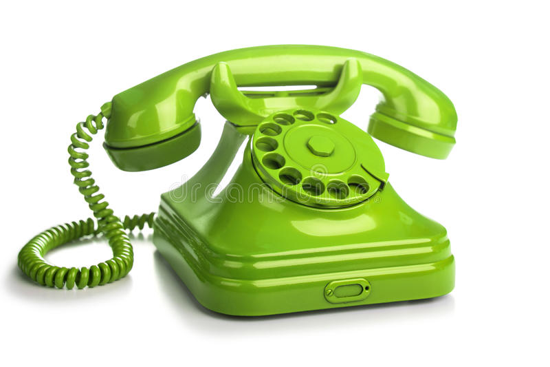 Zielony retro telefon na białym tle obraz royalty free