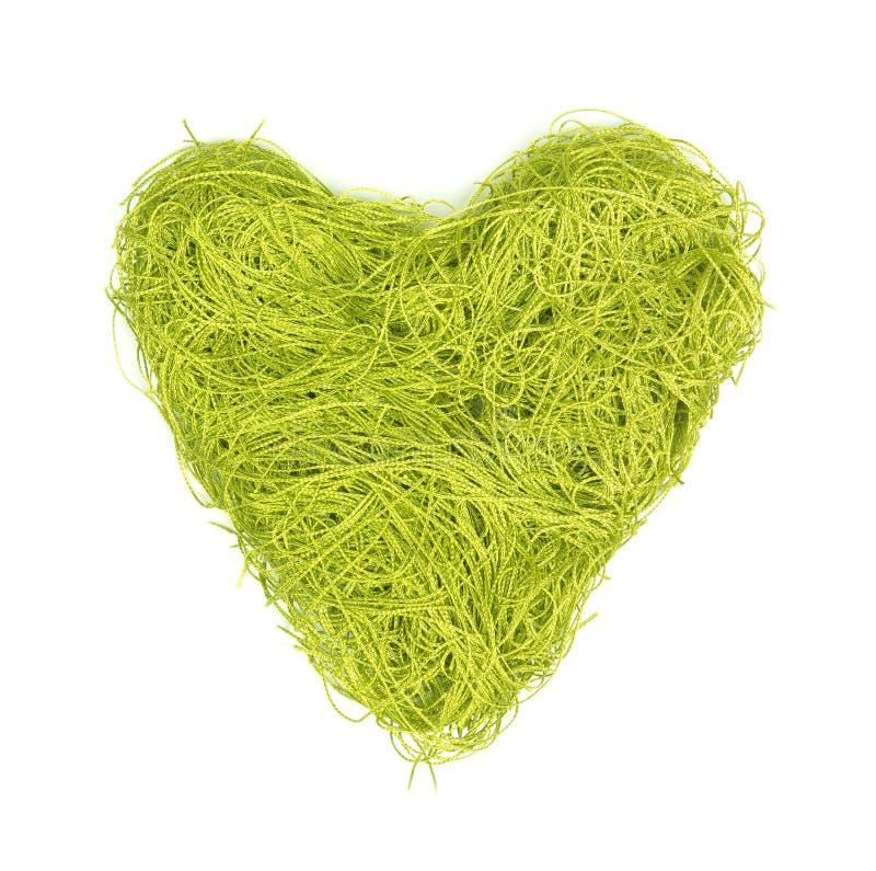 Zielony serce robić sznurki na biały tle obrazy royalty free