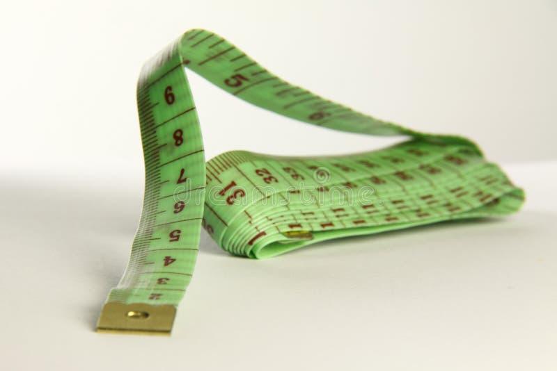 Zielony tapemeasure obraz stock