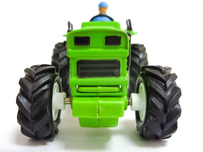 Zielony zabawkarski ciągnik zdjęcie stock