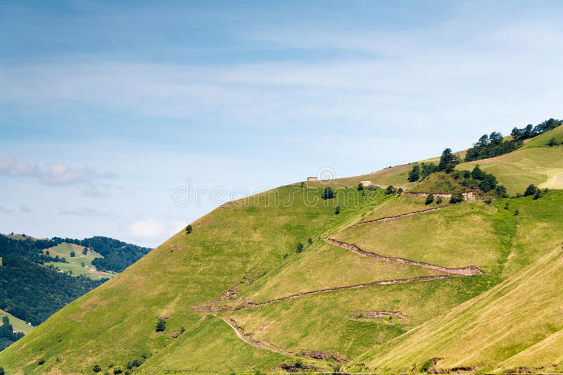 Zig zag road to a house in the mountain. Vega de Pas, Cantabria (Spain royalty free stock images