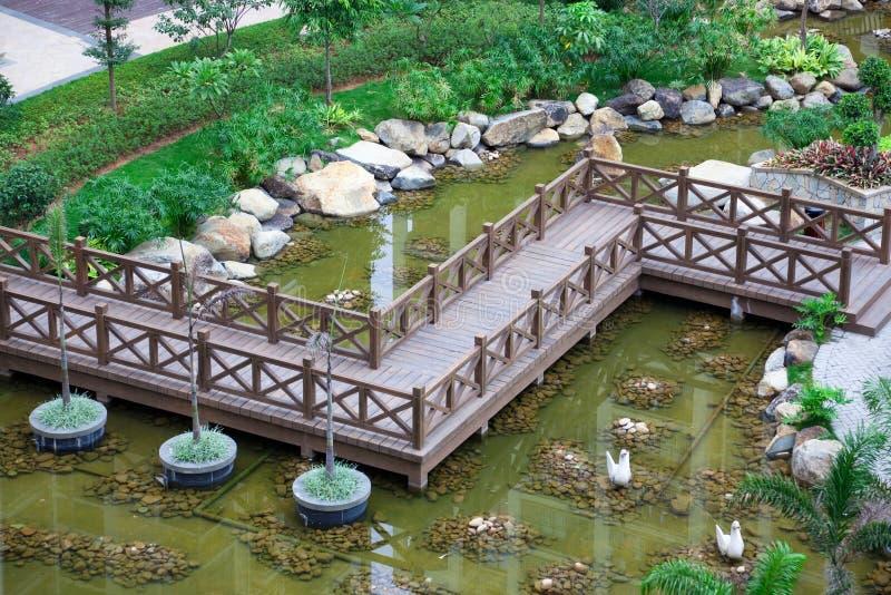 Zig-zag wooden bridge stock photo