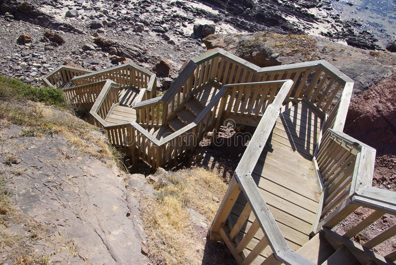 Zigzag Beach Steps. Wooden steps zigzagging down to the rocky beach at Hallett Cove. Adelaide, South Australia stock images